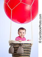 kid girl on hot air balloon in the sky
