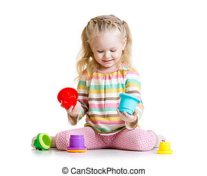 kid girl playing with color toys