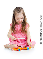 kid girl playing with musical toy
