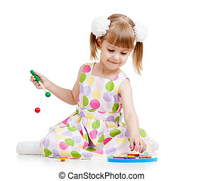 kid girl playing with toys, isolated over white