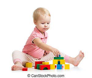 kid girl playing with wooden toys