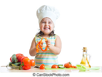 kid girl preparing healthy food in the kitchen