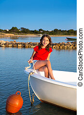Kid girl pretending to be sailor in boat bow at Formentera...