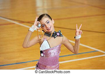 kid girl rhythmic gymnastics on wooden deck medal winner...