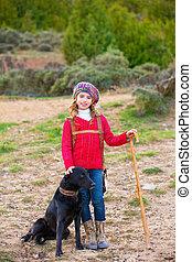 Kid girl shepherdess happy with dog and flock of sheep - Kid...