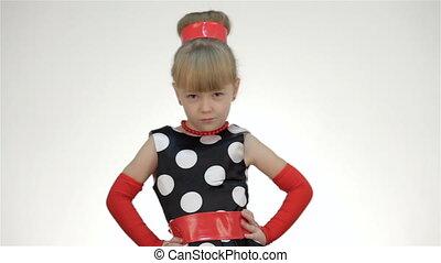 Kid girl with hands on hips abut. Kid girl posing in studio...