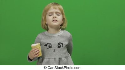 Kid girl with ice cream on a Green Screen, Chroma Key