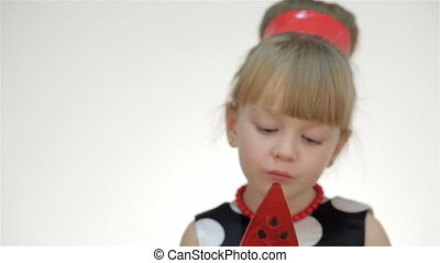 Kid girl with lollipop showing tongue