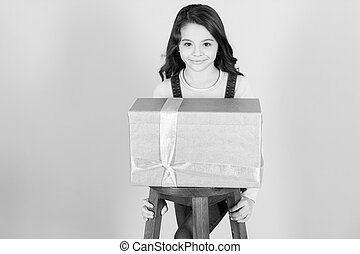 Kid girl with present gift box. black and white happy little girl