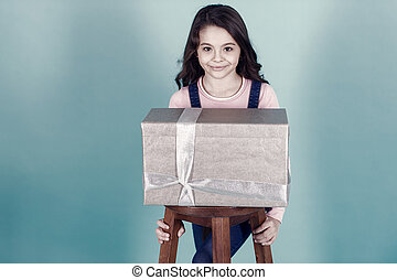 Kid girl with present gift box