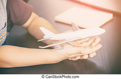 Kid hands is holding a toy plane
