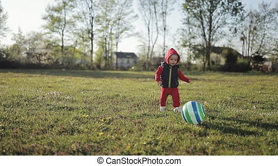 Kid having fun playing with ball.