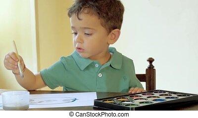 kid having fun with watercolors