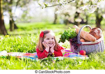 Kid having picnic in blooming garden - Little children...