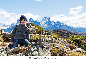 kid hiking in patagonia - kid resting at mirador condor and...