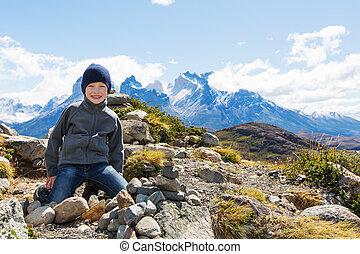 kid hiking in patagonia - kid resting at mirador condor and...