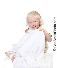 Kid Holding a Bath Towel Smiling