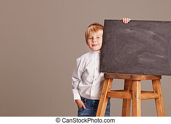 Kid holding a black board