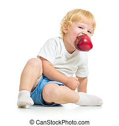 kid holding apple in mouth