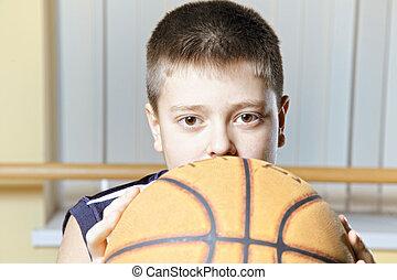 Kid holding basketball