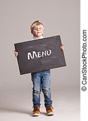 Kid holding board with sign Menu