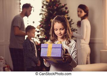 kid holding christmas present
