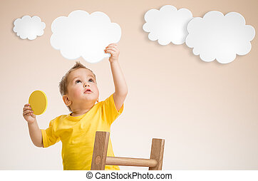 Kid holding cloud in hand