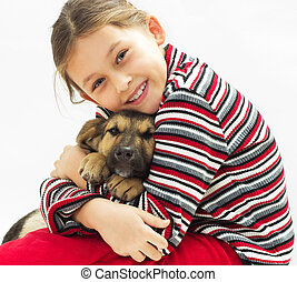 kid hugging puppy on a white background