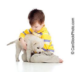 kid hugging puppy on white background