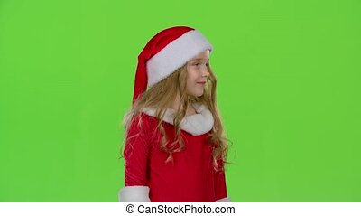 Kid in a red suit are standing in the room and wink. Green...