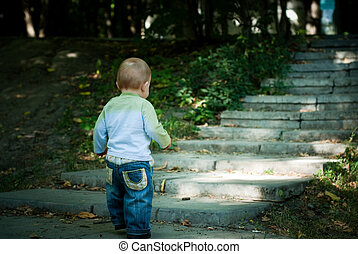 Kid in front of stairs