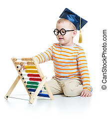 Kid in graduation cap and glasses with colorful abacus isolated on white