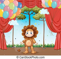 Kid in lion costume on stage