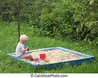 kid in playpit