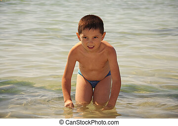 Kid in sea