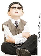 Kid in sunglasses looks up