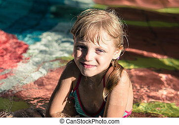 kid in the swimming pool