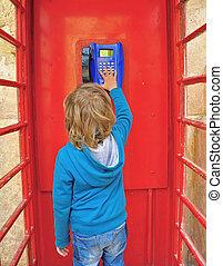 Kid in the telephone box