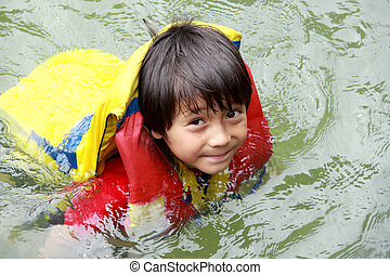 kid in the water