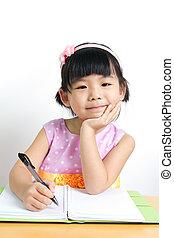 Kid is doing homework - Little kid is doing her home work...