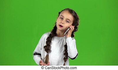 Kid is on the phone. Green screen . Slow motion - Kid speaks...