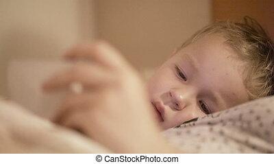 Kid is watching smart phone