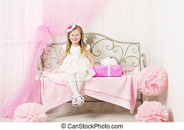 Kid Little Girl Portrait, Smiling Child four years with Pink Present Gift Box in Decorated Children room