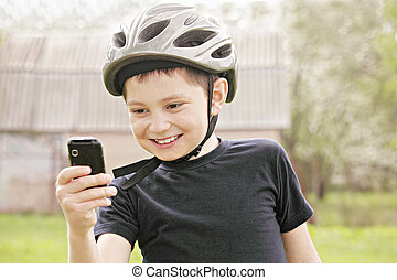 Kid making shot with phone