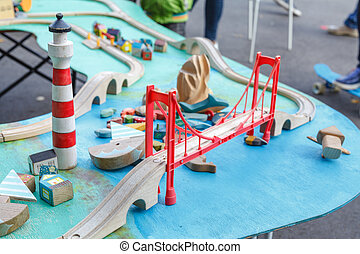 Kid model railway locomotive and layout with a station and whole scene