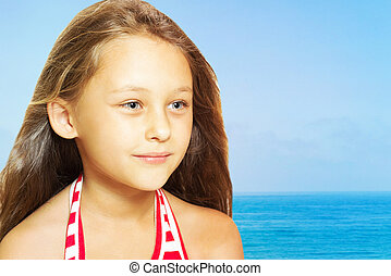 kid on a background of the sea