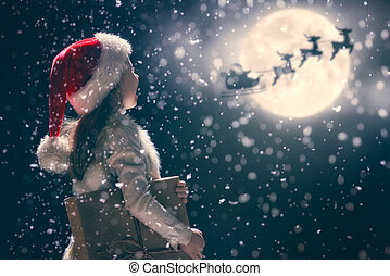 kid on dark background - Merry Christmas and happy holidays!...
