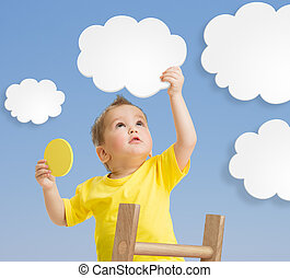 Kid on ladder holding cloud and sun