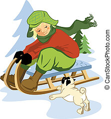 Kid on sleigh in the snow