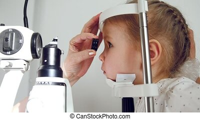 Kid ophthalmology - optometrist checking little child's...